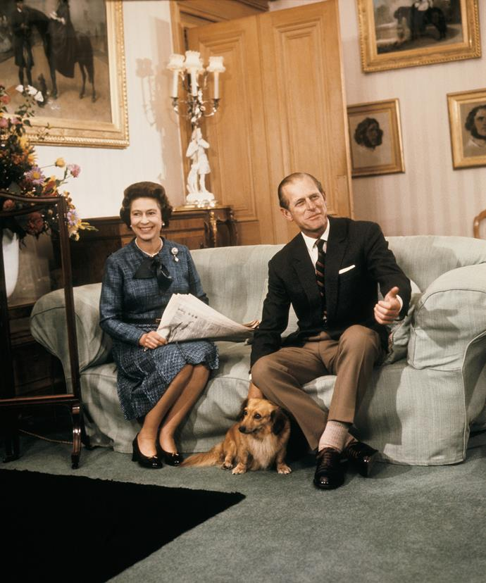 Queen Elizabehg and Prince Philip with a corgi in the drawing room of Balmoral Castle, 1977