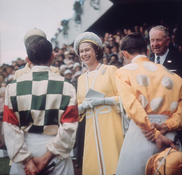 Queen Elizabeth greets jockeys at the Randwick racecourse in 1970.