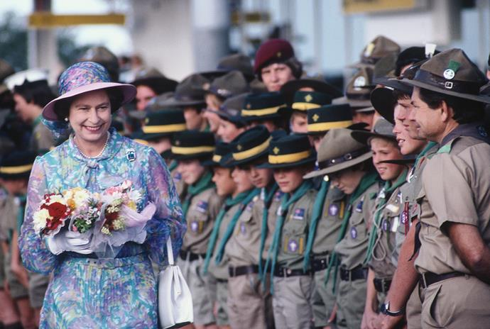 Elizabeth is greeted by a team of boy scouts in Brisbane in 1982.