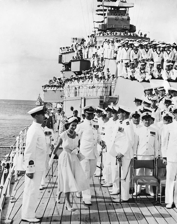 A laughing Queen Elizabeth aboard the HMS Australia in 1954.