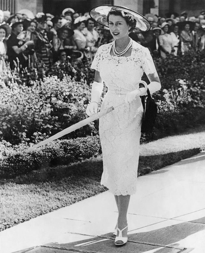 Queen Elizabeth, looking chic in slim white dress, attends a garden party in Sydney in 1954.
