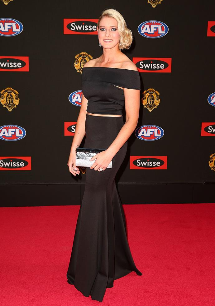 Female footy player Tayla Harris goes for classic glamour - with a glimpse of mid drift.