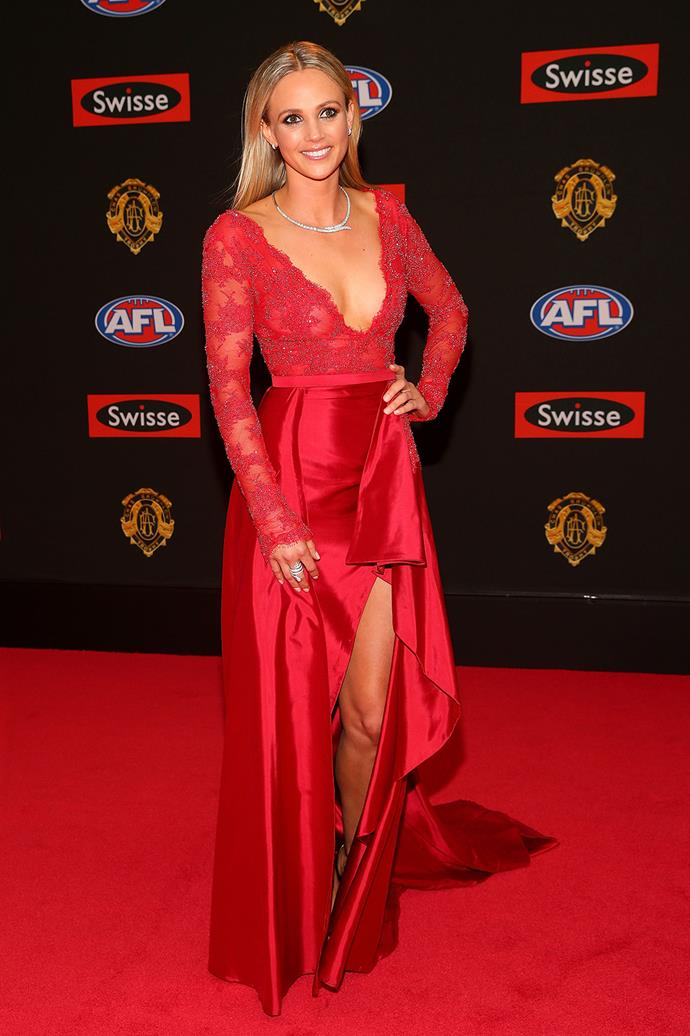 David Armitage's partner, Jessie Hultgren, gives us the first spot of colour in her red, plunging dress.