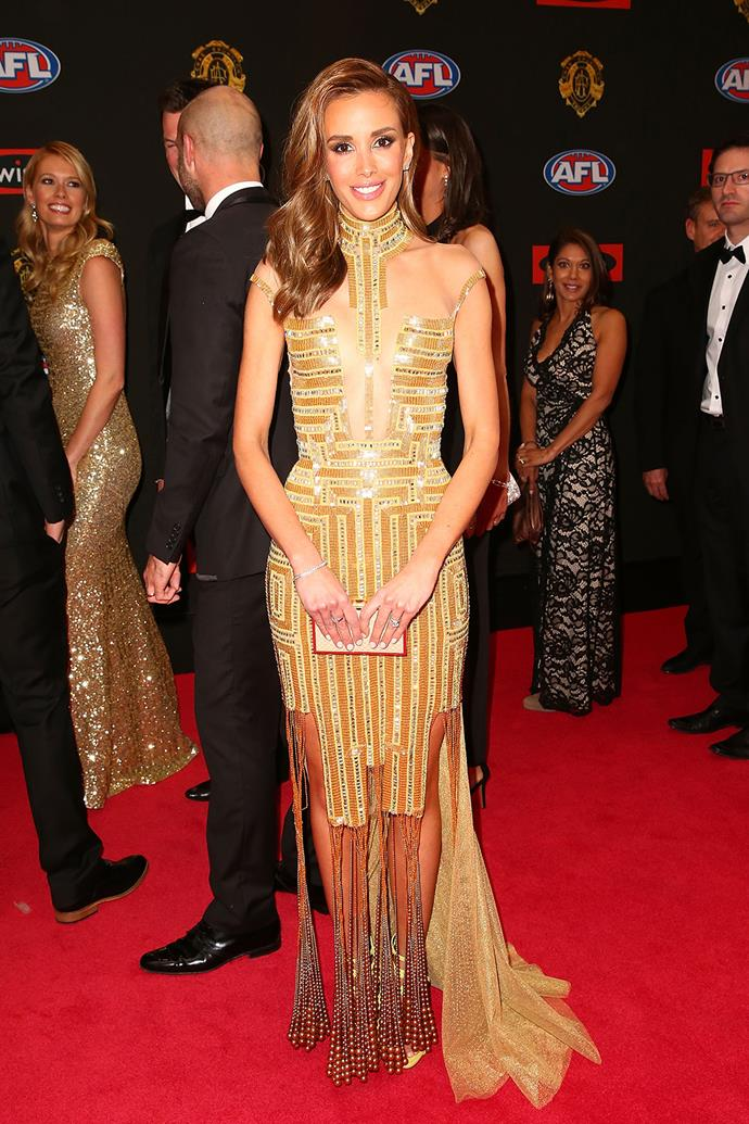Rebecca Judd, wife of Carlton player Chris Judd, in Egyptian-inspired gold.