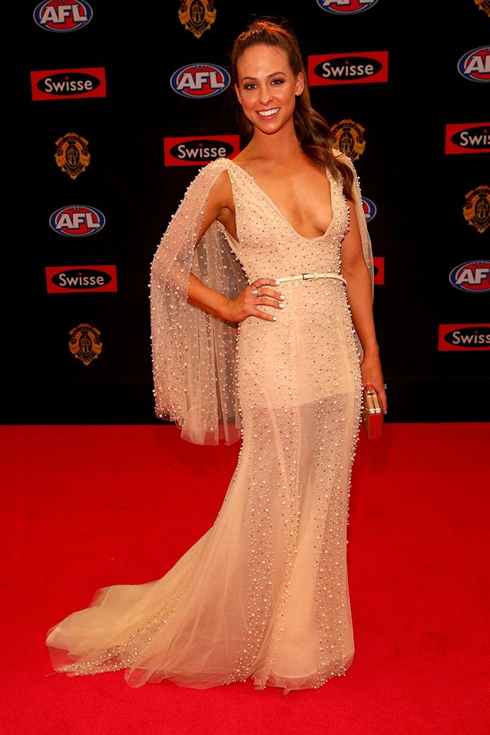 Mardi Harwood, partner of Patrick Dangerfield, in a beaded caped gown.