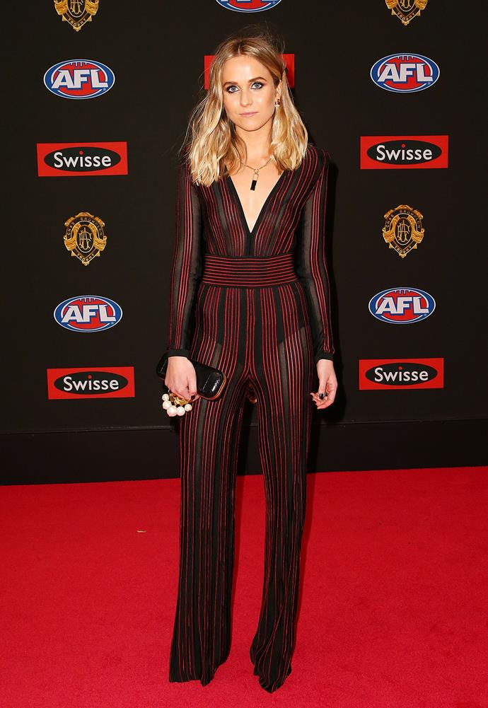 Pip Marques, partner of Josh Bruce, in a Balmain striped jumpsuit.