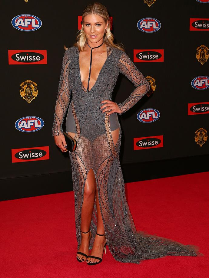 Rebeccah Panozza, partner of Collingwood's Travis Cloke, in a grey sheer dress.