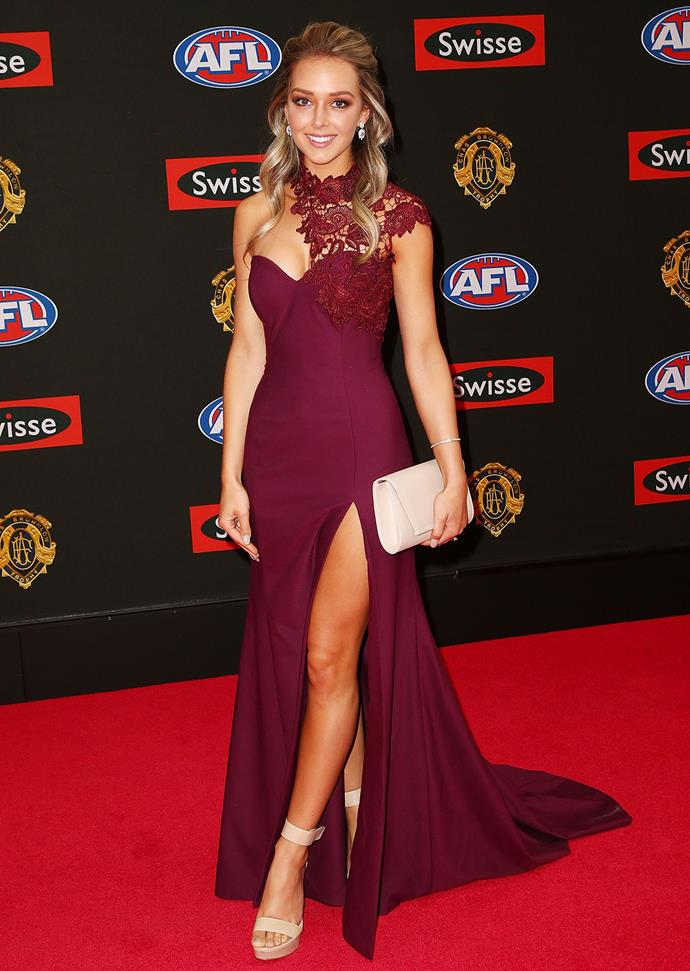 Keely Meehan, partner of Dayne Beams, in a plum gown with a lace shoulder.