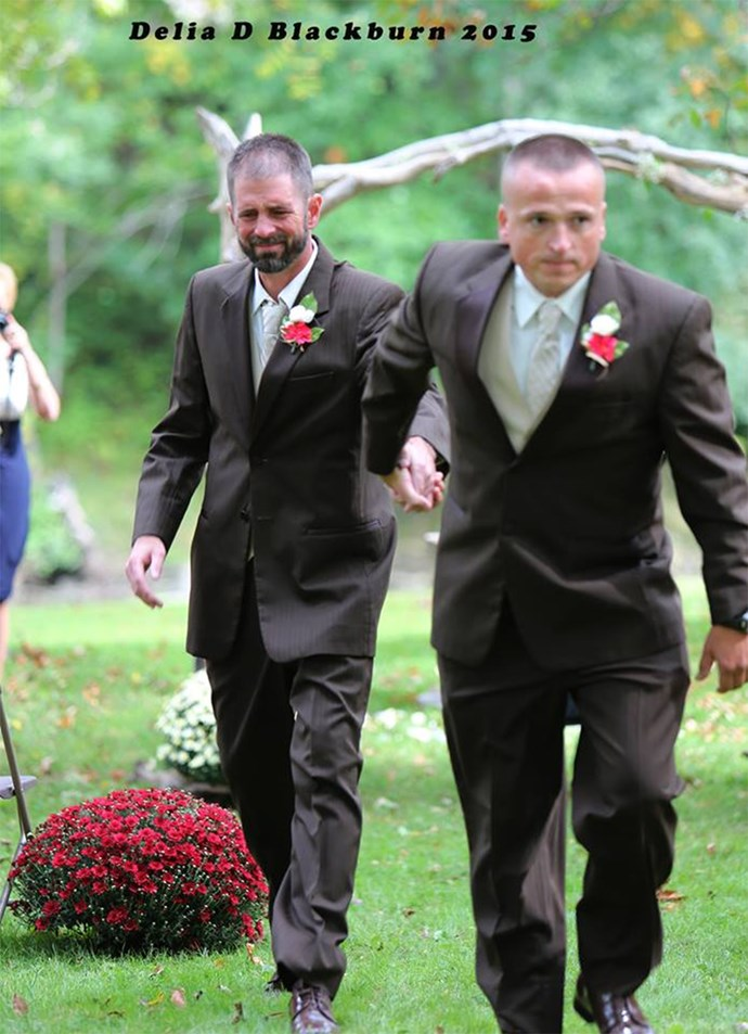 "Father-of-the-bride, Todd Bachman, pulls his daughter's step-father down the aisle with him. / Image via [Delia D Blackburn](https://www.facebook.com/Delia-D-Blackburn-Photography-673664349370045/timeline/|target=""_blank"")."