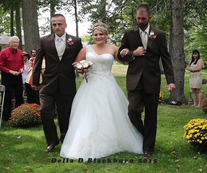 "The bride with her two fathers. / Image via [Delia D Blackburn](https://www.facebook.com/Delia-D-Blackburn-Photography-673664349370045/timeline/ target=""_blank"")."