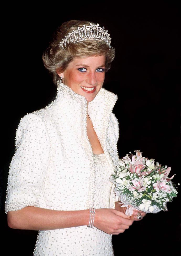 Diana was known for her love of pearls and sapphires, which she wore regularly. Here she is wearing one of her favourites, the Cambridge Lover's Knot tiara.