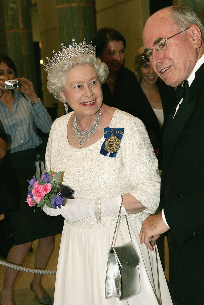 GLITTERING CROWN JEWELS At an official dinner at Parliament House in Canberra in March 2006, at 79 years old, Her Majesty dazzled again in a white beaded evening gown. While the dress was a statement in royal style, it was the Queen's jewels which drew gasps. She wore the 'Girls of Great Britain and Ireland' tiara, a wedding gift to Queen Mary who duly passed it on to her granddaughter on her wedding day. The four-stranded pearl watch stands out on Her Majesty's white gloves.