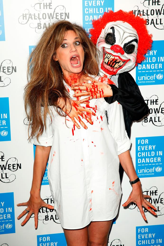 Jemima Khan looks pretty spooked by the creepy clown attached to her shoulder. We don't blame her!