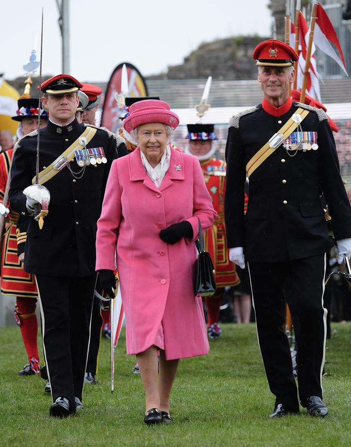 """Famous for wearing colourful clothing, the Queen once remarked: """"I can't wear beige because people won't know who I am."""""""