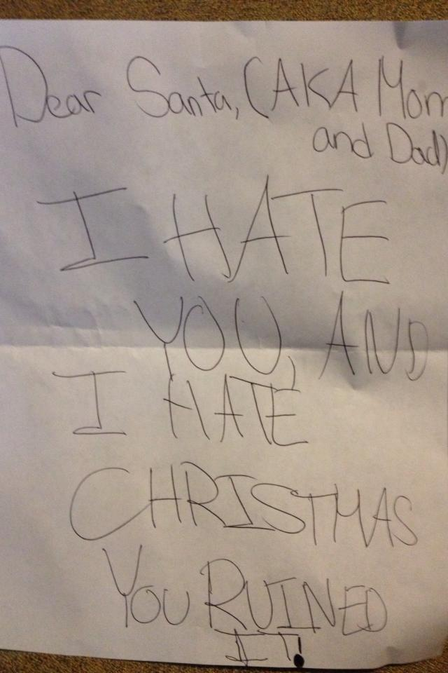Oh, no. Looks like these parents have a little Grinch on their hands - nothing a bit of Christmas ham won't fix... we hope!