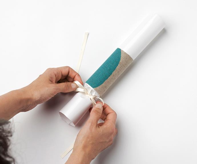 Carefully twist the overhang and secure with ribbon.