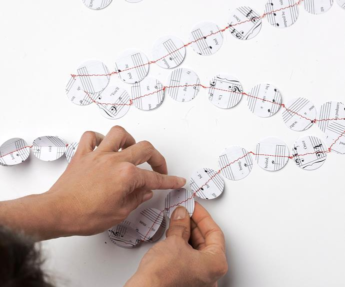 Once all the circles have been sewn together into a garland, bend the double layers of each disc so that they are folded open.