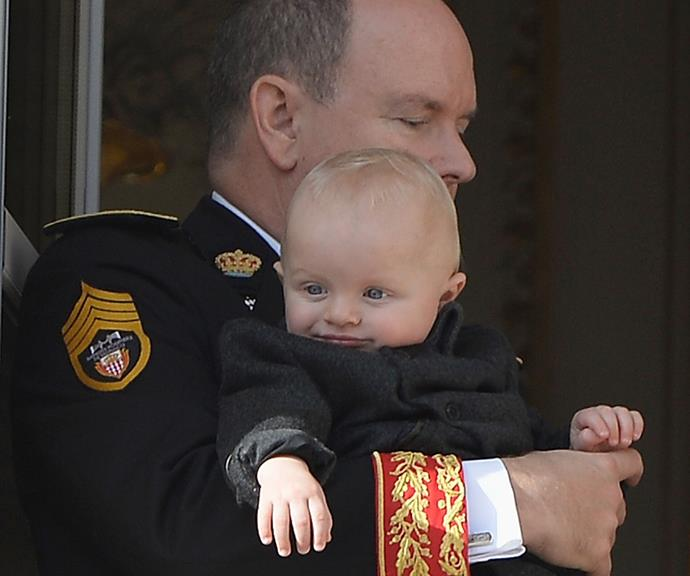 Prince Jacques, in the arms of his father, looked happily at the crowds.