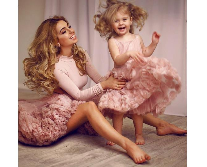 """Bouncing curcls and fluffy, pink dresses. Could this Mummy-Daughter pair get any sweeter? Photo via [@vicoolyasaida](http://instagram.com/vicoolyasaida