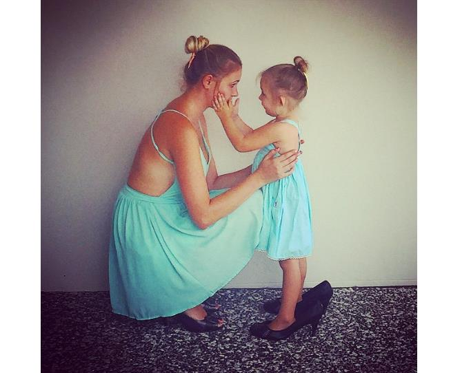 """We're not sure what's sweeter - the matching dresses, or little miss gently holding her mum's face. Photo via [@sienna.scarlett](http://instagram.com/sienna.scarlett