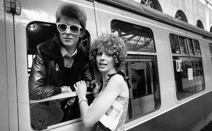 1973: Pop singer David Bowie is seen off at the station by his wife Angie. (Getty)