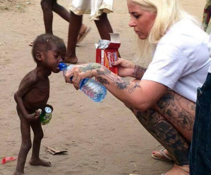 "Photo captures the moment an aid worker gives a starving two-year-old boy water after he was left for dead by his family because they thought he was a witch. [TO DONATE CLICK HERE]( http://www.dinnoedhjaelp.dk/|target=""_blank"")"