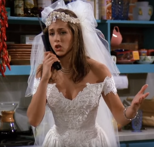 """*The One Where It All Began*. We first get introduced to Rachel as she leaves Barry at the altar and tells her dad on the phone that she """"doesn't want to be a shoe"""" repeatedly. Good for you, Rach!"""