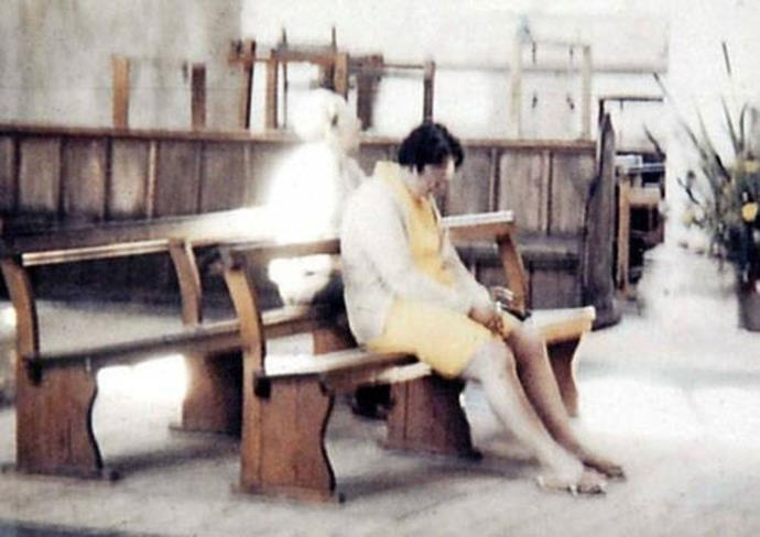 A woman who sat down to pray in a church in Norfolk in 1975 swears there was no one behind her, but her husband's photo begs to differ. She was horrified to later see 'The White Lady' appear in the picture in old-fashioned clothes and a bonnet.