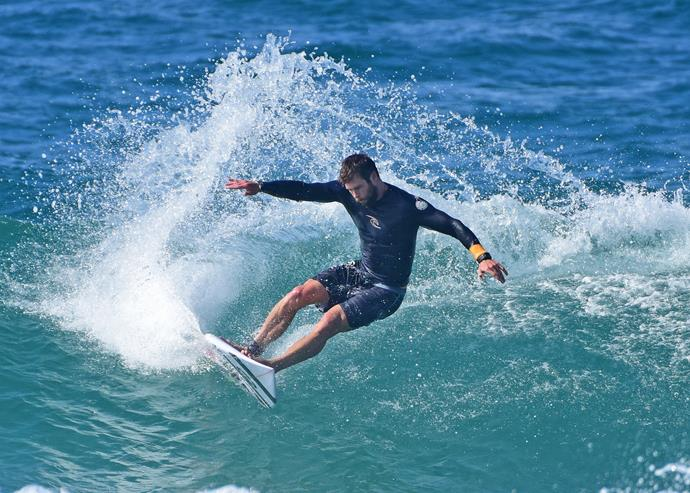 When he dominated the waves near his home in Byron Bay.