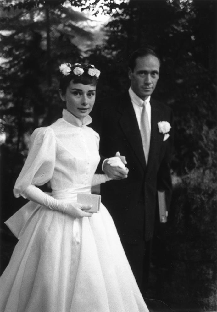25th September 1954: Film star couple Audrey Hepburn (1929 - 1993) and Mel Ferrer on their wedding day. Dress designed by Balmain. (Photo by Ernst Haas/Ernst Haas/Getty Images)