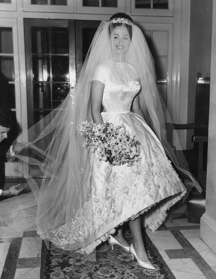 13th December 1960: Actress and author Jackie Collins celebrates her marriage to businessman Austin Wallace at Grosvenor House in London after a registry office ceremony. Her white satin wedding dress with intricate beading cost £400. (Photo by Central Press/Getty Images)