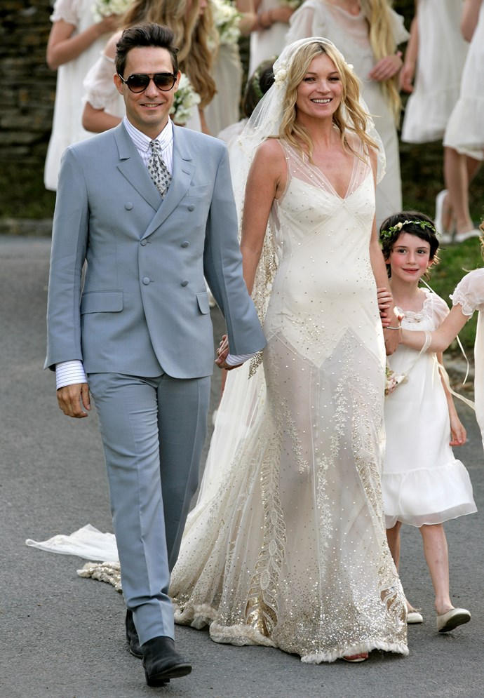 Jamie Hince and Kate Moss pose for photographs as they leave St. Peter's Church after their wedding on July 1, 2011 in Abingdon, England. (Photo by Indigo/Getty Images)