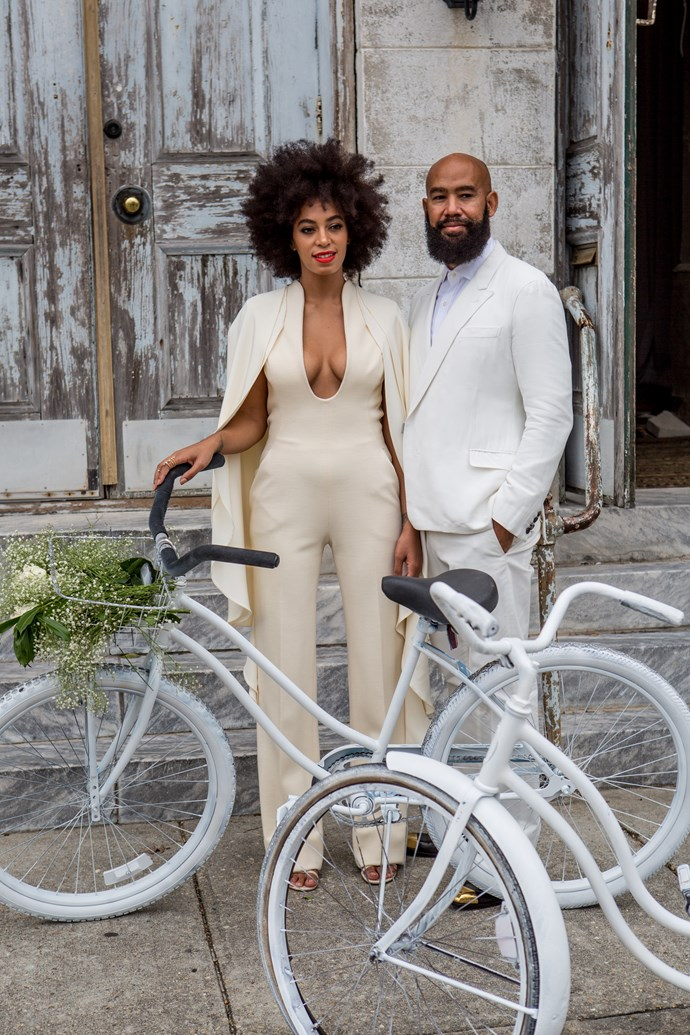 Musician Solange Knowles (wearing a pre-ceremony ensemble by Stephane Rolland) and her fiance, music video director Alan Ferguson, ride bicycles on the streets of the French Quarter en route to their wedding ceremony at the Marigny Opera House on November 16, 2014 in New Orleans, Louisiana. (Photo by Josh Brastead/WireImage)