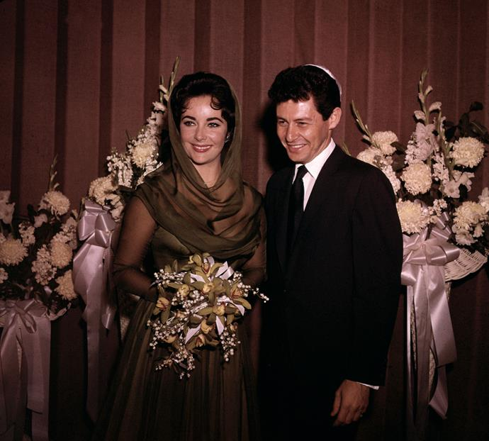 Eddie Fisher and Elizabeth Taylor are shown after their wedding at Temple Beth Shalom in 1959. No pictures were allowed during the actual wedding ceremony.