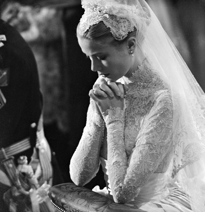 Grace Kelly prays during her wedding to Prince Rainier of Monaco on April 20, 1956.