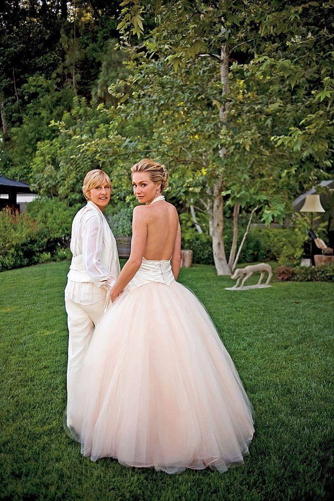 Comedian Ellen DeGeneres and actress Portia de Rossi pose for photos celebrating their marriage in the backyard of their home on August 16, 2008 in Beverly Hills, California. (Photo by Lara Porzak Photography via Getty Images)