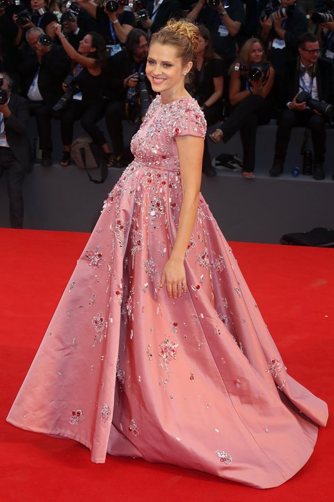 Teresa's stunning gown is by Prada.