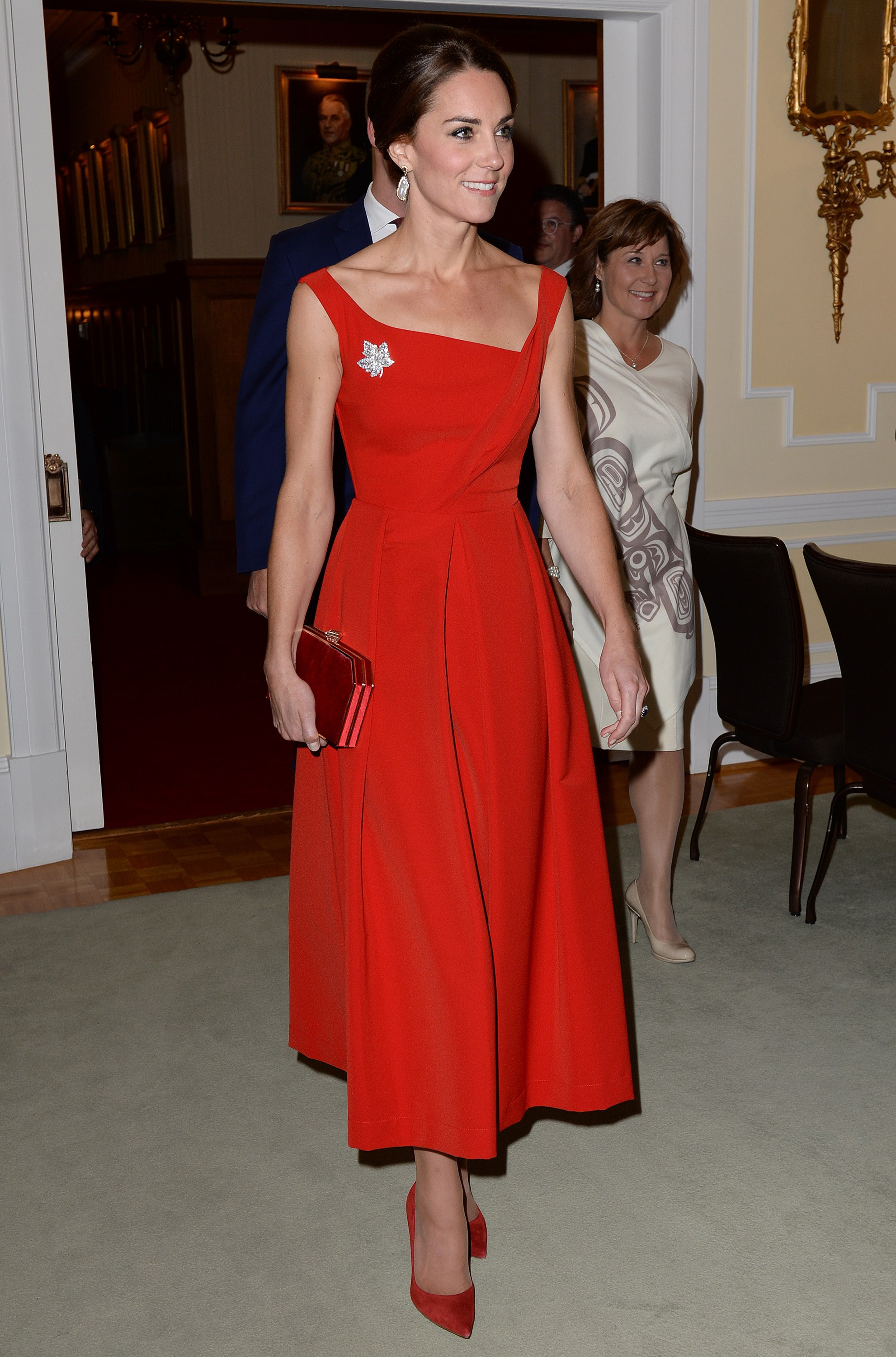 Is this the Duchess' most stunning look ever? This gorgeous red gown is by Preen by Thornton Bregazzi, which she wore with a maple leaf brooch in homage to the Canadian flag. She and William were dressed up to attend a reception for political and civic leaders in British Columbia.
