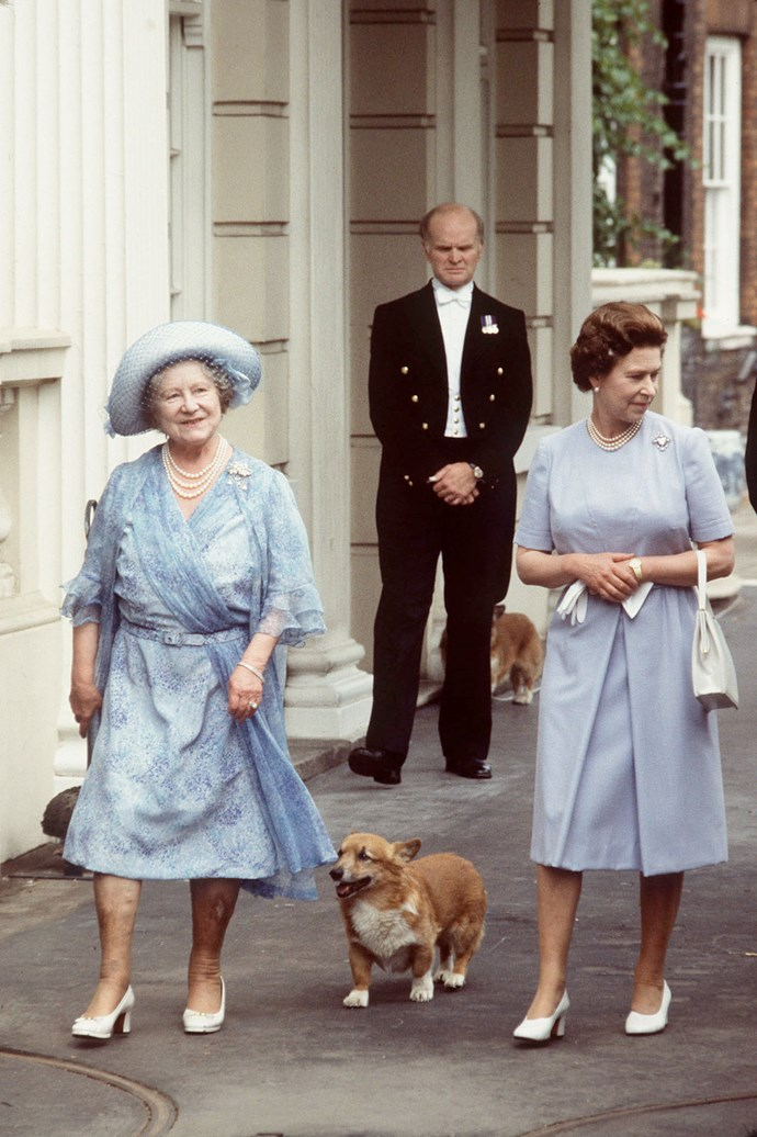 The Queen and Queen Mother walking the corgis  outside Clarence House.