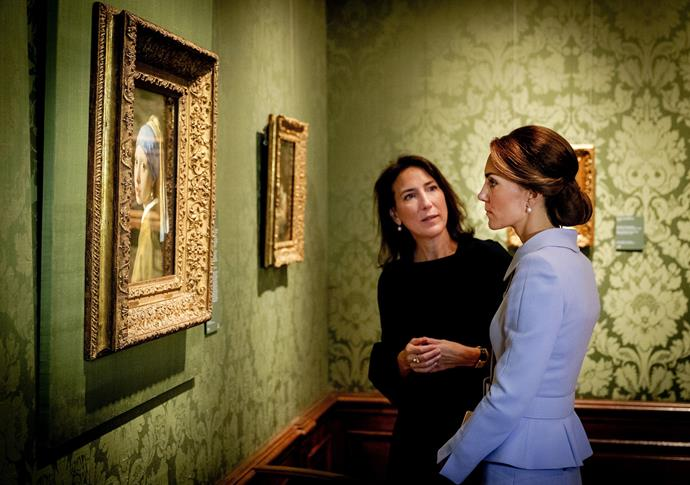 Kate looks at the famous Dutch 17th century painting 'Girl with a Pearl Earring' by Johannes Vermeer during her visit to the historic Mauritshuis Museum in The Hague's city centre.