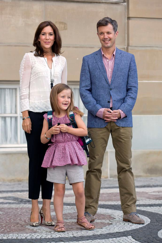 Crown Prince Frederik, and Crown Princess Mary of Denmark, with their daughter Princess Isabella depart Amalienborg Palace for Princess Isabella's first day at Tranegard School in 2013.