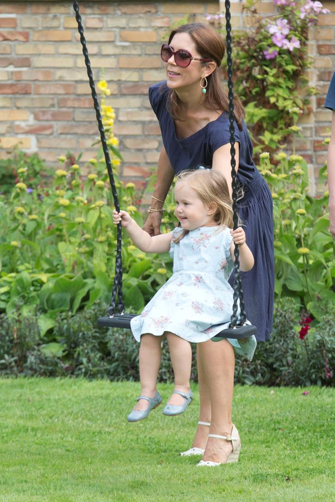 2013: Crown Princess Mary of Denmark with her daughter Princess Josephine of Denmark at the annual Summer photocall for the Royal Danish family at Grasten Castle.