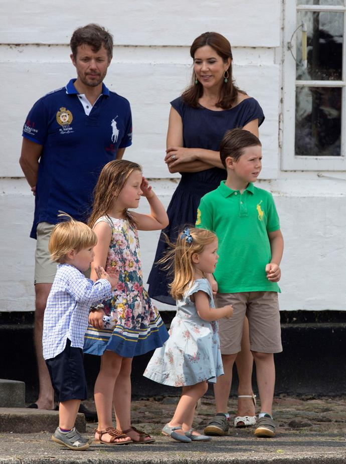 2013: Crown Prince Frederik, and Crown Princess Mary of Denmark with their children Prince Christian, Princess Isabella, Prince Vincent, and Princess Josephine watch the Guard change at Grasten Castle after attending the annual Summer photocall.