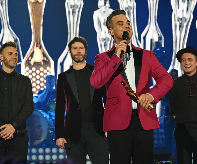 Oh what a night! Robbie was joined by Gary Barlow, Mark Owen, and Howard Donald as he collected his award.