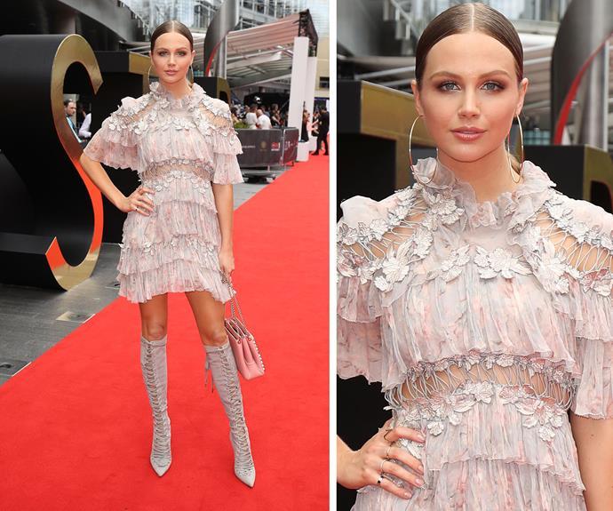 Ksenija Lukich looks angelic in baby pink.