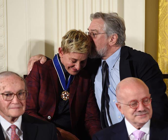 Actor Robert De Niro hugs actress and comedian Ellen DeGeneres after she was presented with the Presidential Medal of Freedom.
