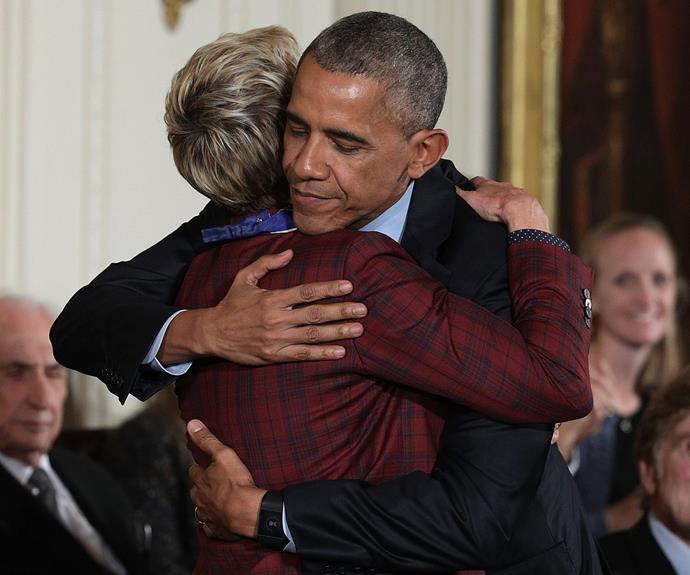 Barack Obama hugs Ellen after presenting her with her award.