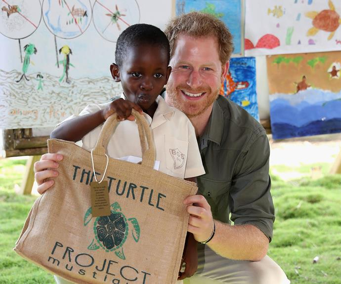 The 32-year-old makes a pal as he visits the Turtle Conservation Project in Colonarie, Saint Vincent and the Grenadines.