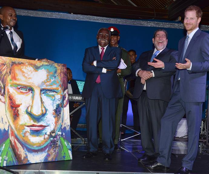Prince Harry was gifted a painting of himself during a reception on the island of St Vincent and the Grenadines. By the looks of it, he approves.