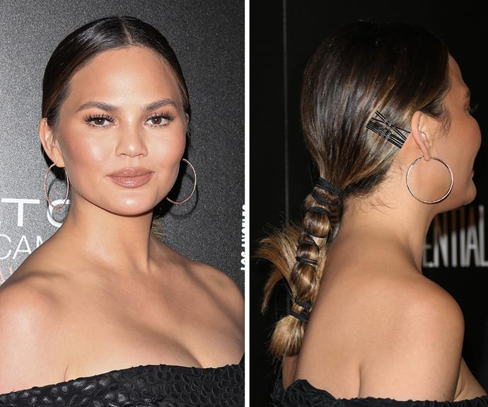 **Chrissy Teigen's** party ponytail is the perfect way to make you feel different (and way more glam) than you do wearing your go-to gym/work/supermarket ponytail. Once you've got your regular ponytail done, simply channel your inner Princess Jasmine and tie extra elastics down your ponytail, about one inch apart. Use a little anti-frizz serum to smooth any flyways, too.